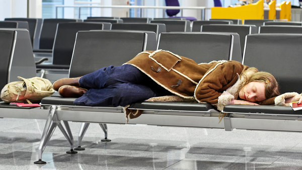 Med thumb sleeping airport featured