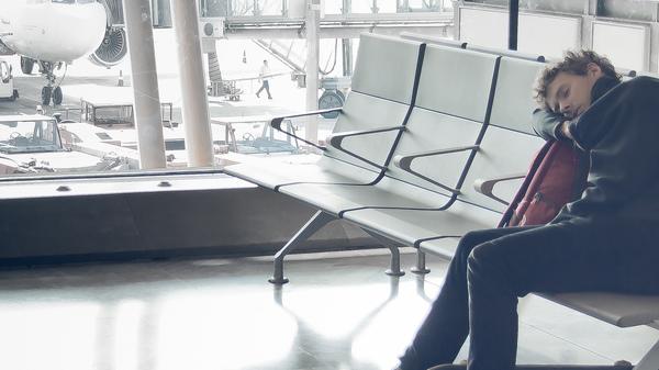 Med thumb sleeping at airport 3