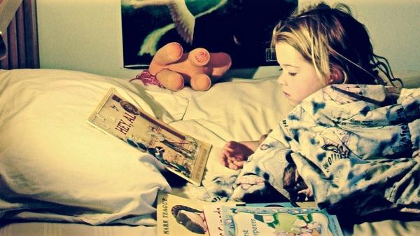 Med thumb girl reading in bed