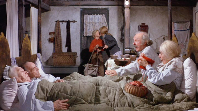 "why did the grandparents in willy wonka sleep in the same bed  charlie s mother mrs bucket explains the situation "" the four of you bedridden for the last 20 years it takes a lot to keep this family going """